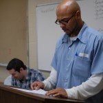 LorCI inmate S.A. Grant recites his poem during Dr. Daniel Cleary's poetry class in the prison.