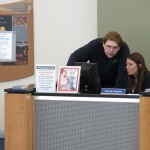 Student workers Charles Nichols and Nunzia Crispino at the Student Life desk.