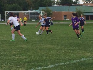 Taylor Savarino (left) defends the ball in the match against Ashland Sept. 30.