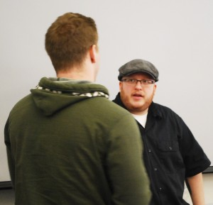 Drew Scofield answering a question from a student in the JRNM 151 class.
