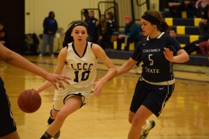 Lorain County Community College Women's Basketball guard Madi Bonner dribbles past Columbus State in their Feb. 3 game.