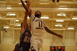 Kevin Jenkins goes up for a layup in the Feb. 13 men's match against Sinclair CC.