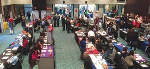 Job hunters and employers alike crowd the Spitzer Conference Center on April 7.