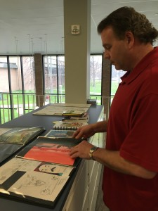 Rebecca Marion | The Collegian Dr. Kimberlin examines the artwork he's received from inmates.