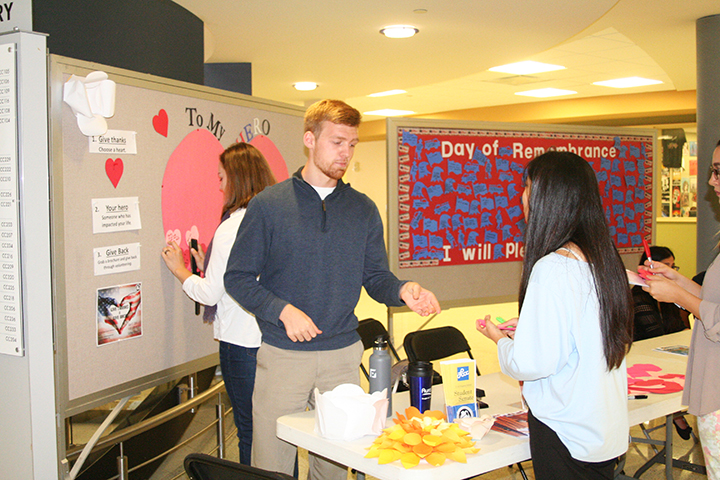 Traci Kogut| The Collegian Members of the Lorain County Community College Student Senate hang up thank you notes from students during this year's Sept. 11 memorial. The notes will be delivered to local police and fire departments on Friday, Sept. 16.