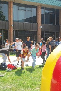 Early College High School students Ashley Metcalf and Kachina Lester stair their race through the obstacle course. Photo by Kristin Hohman