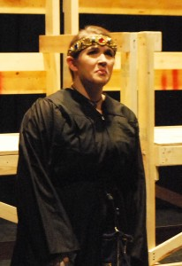 "Lizzie Tomcho as ""Queen Rosemund"" laments the assassination attempt on her husband, King Wenceslas."