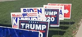 A row of campaign signs in Lorain. Photo: Harleyann McQuaid